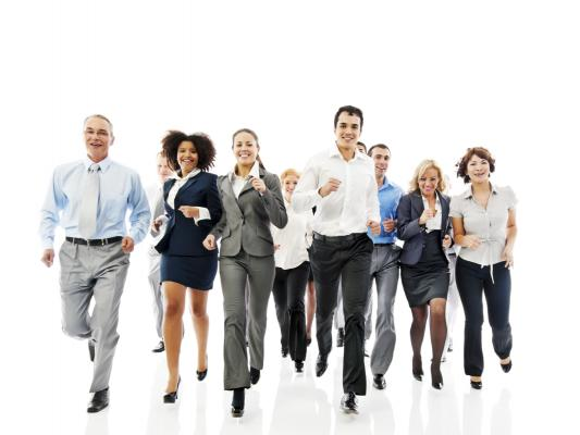 Employees happily jogging in business clothes