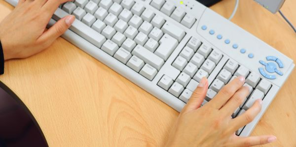 Keyboard used by female hands